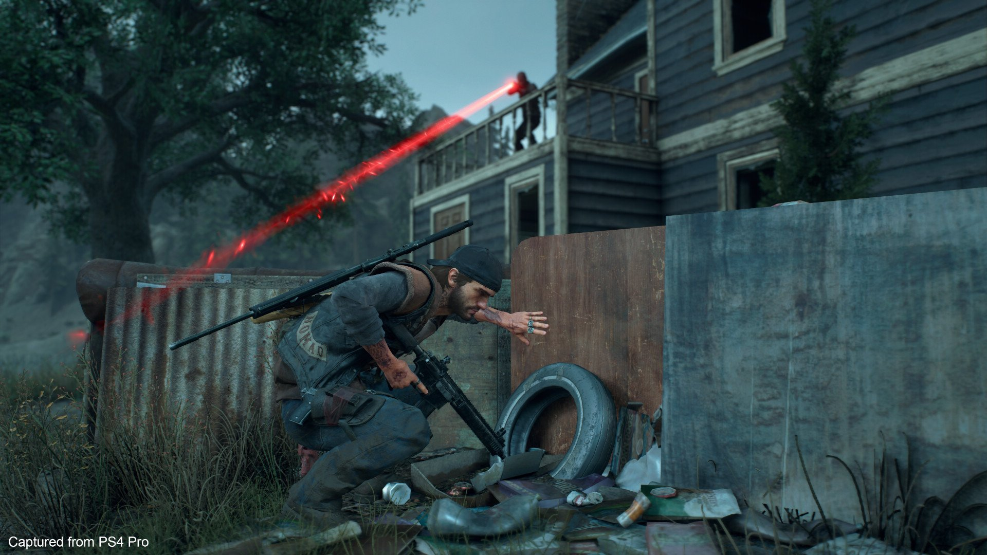Days Gone screenshot Deacon hides from a sniper
