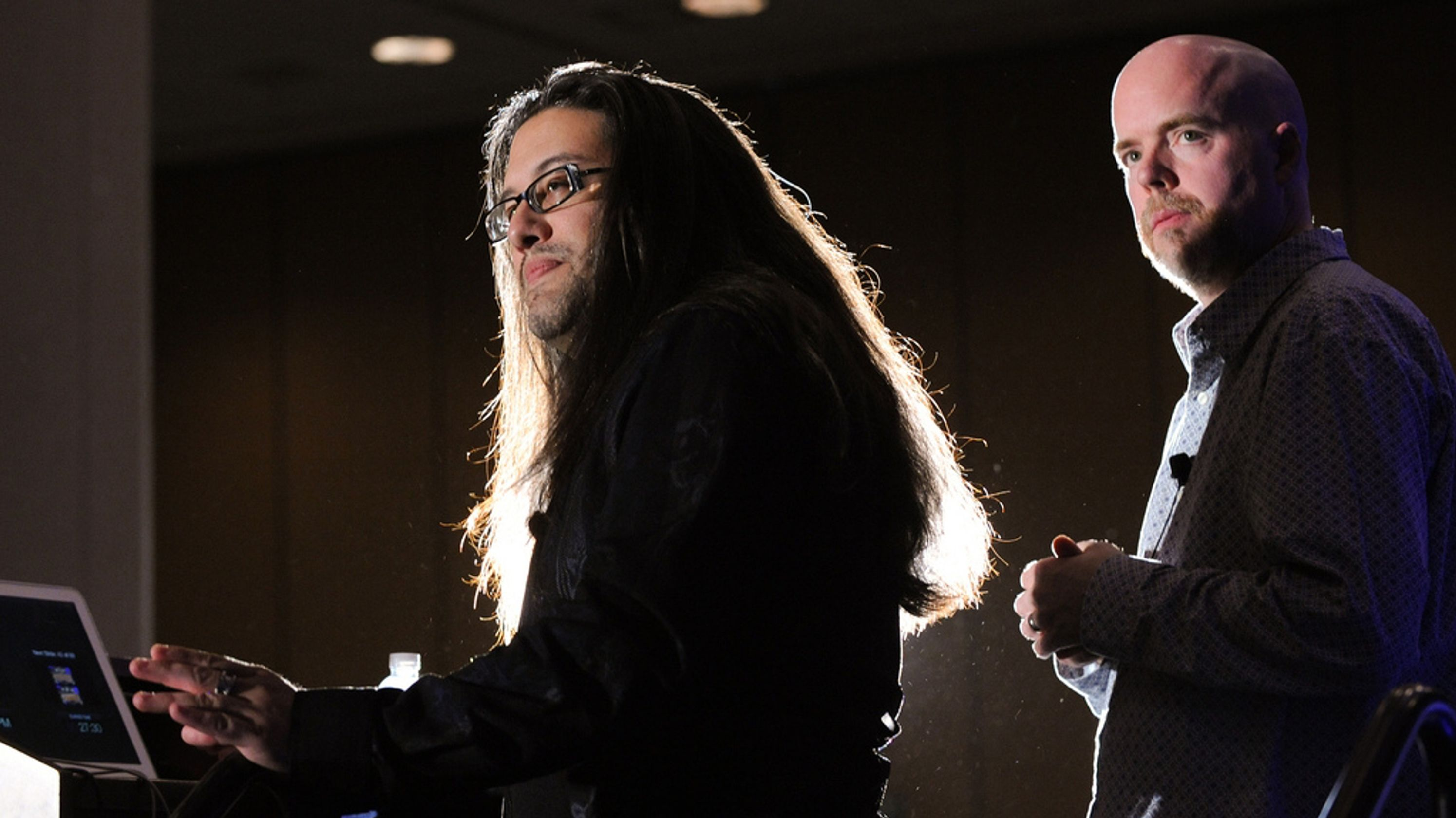 John Romero (left) and Tom Hall give a postmortem of Doom at GDC 2011.