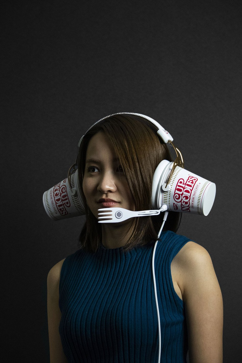 These headphones may look ridiculous, but the cups are home to tasty noodles.