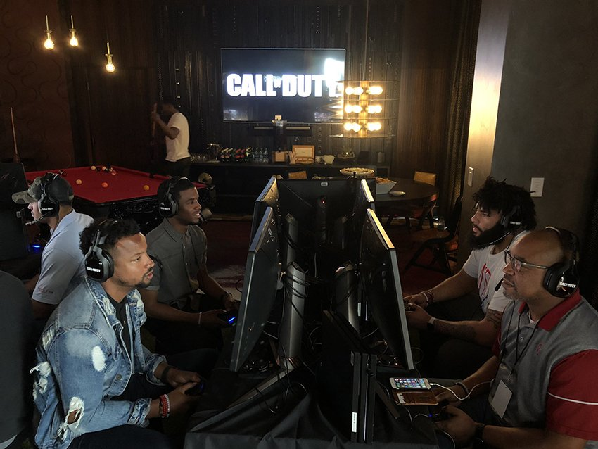 Several football players play the new Call of Duty at a special event last month.