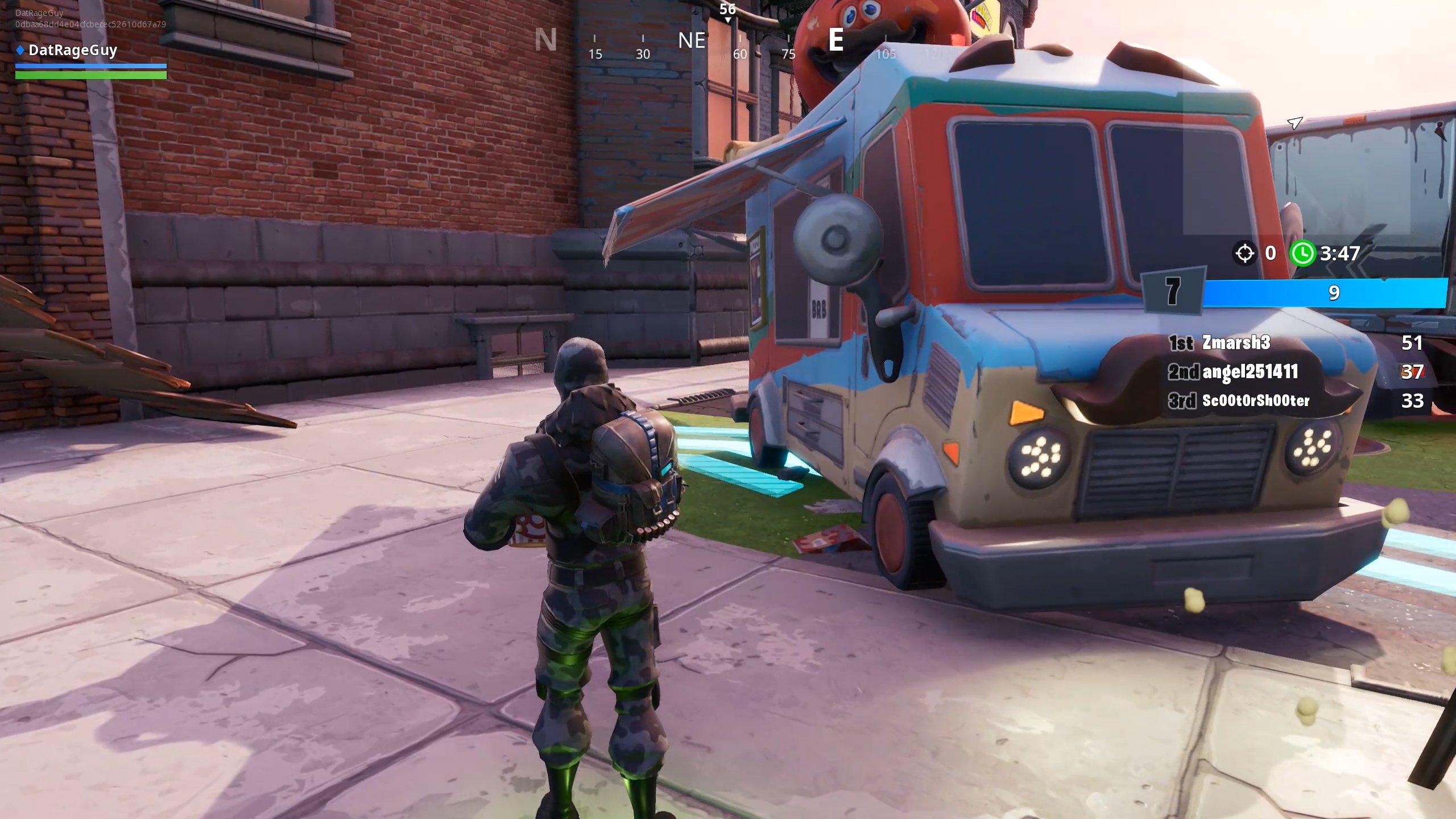 Dance or emote between two food trucks in Fortnite Downtown Drop