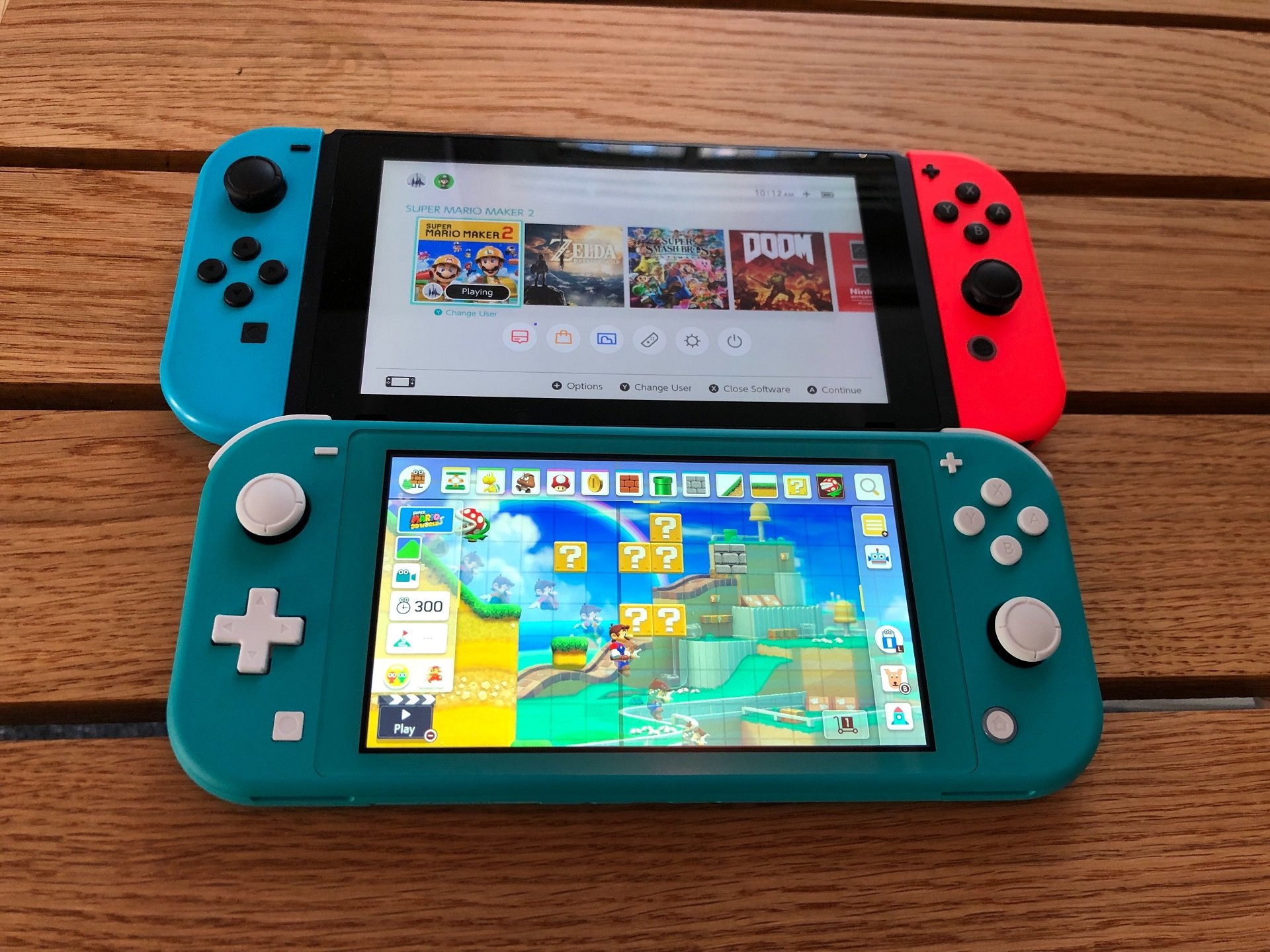 The Nintendo Switch Lite and the original Nintendo Switch, side by side.