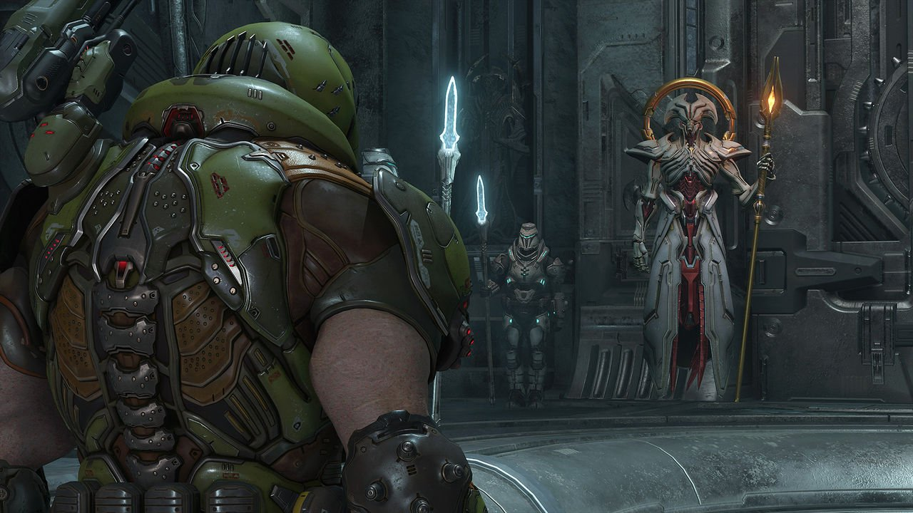 Doom Slayer pauses to listen to someone yammer at him before getting back to ripping and tearing.