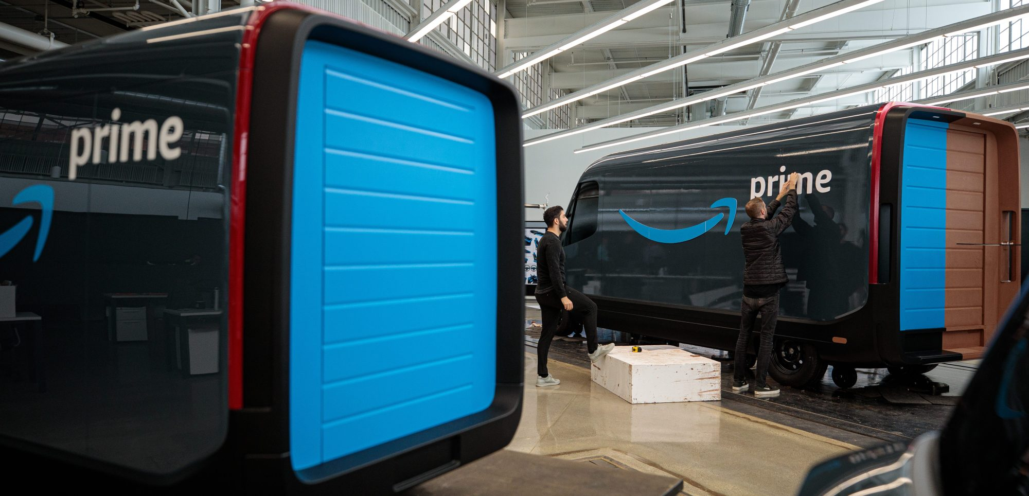 Amazon owns a stake in Rivian and has committed to deploying 100,000 electric delivery vans in their fleet.