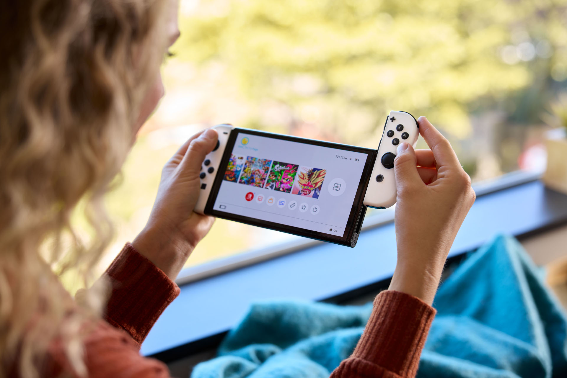 The Nintendo Switch OLED model offers a brighter, slightly larger screen.